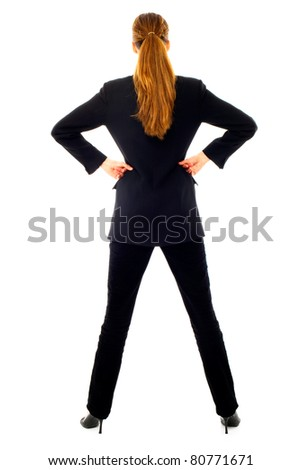 Young businesswoman standing back on white background studio - stock photo