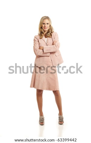Young businesswoman standing with arms crossed - stock photo
