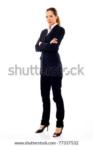 Young businesswoman standing with arms crossed on white background studio - stock photo