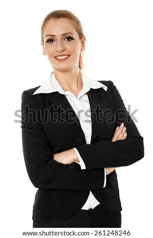 Young businesswoman standing with crossed arms, closeup portrait - stock photo