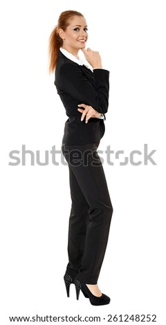 Young businesswoman standing with hand on chin, full length portrait - stock photo