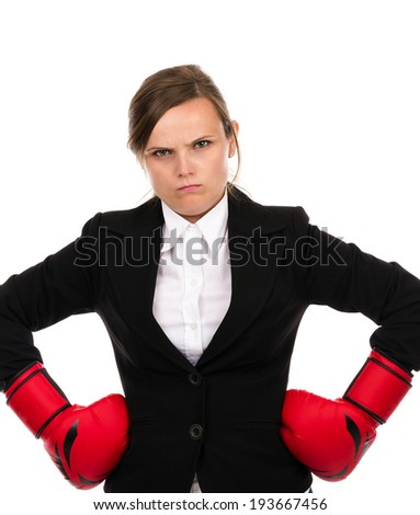 Young businesswoman standing with hands on hips wearing boxing gloves ready for the competition isolated over white background - stock photo
