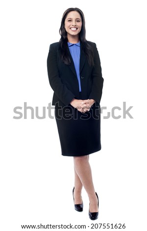 Young businesswoman standing with her hands clasped