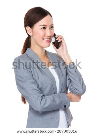 Young businesswoman talk mobile phone - stock photo