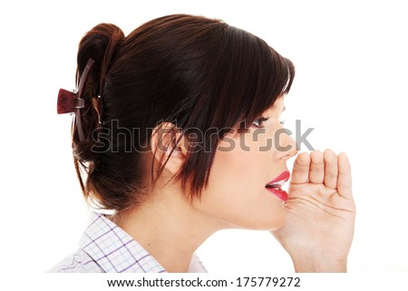Young businesswoman talking gossip, isolated on white