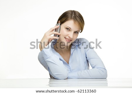 young businesswoman talking on a mobile phone - stock photo