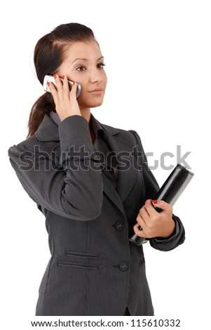 Young businesswoman talking on mobile phone, holding personal organizer. - stock photo