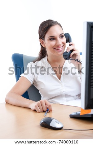Young businesswoman talking on the phone in her office - stock photo