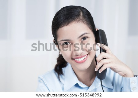 Young businesswoman talking on the telephone at the office.