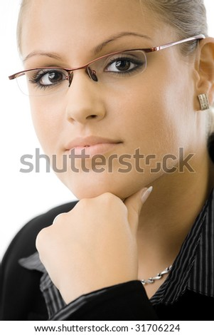 Young businesswoman thinking, isolated on white background. - stock photo