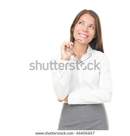 Young businesswoman thinking smiling looking up holding glasses. Isolated on white background. Young Asian / Caucasian female model. - stock photo
