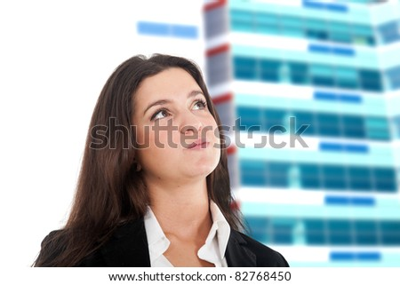Young businesswoman thinking something. Out of focus construction and sky in the background. - stock photo