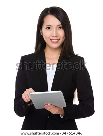 Young Businesswoman use of the tablet pc - stock photo