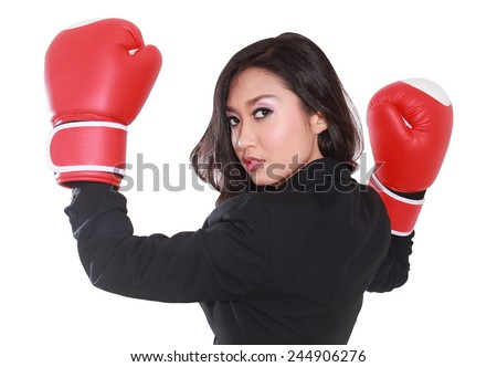 young businesswoman using boxing gloves, isolated on white background