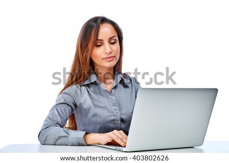 Young businesswoman using laptop. Isolated on a white background