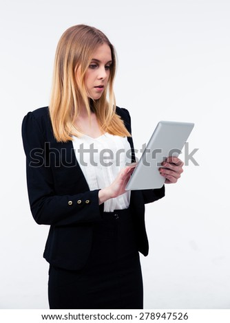 Young businesswoman using tablet computer over gray background - stock photo