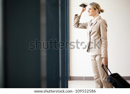 young businesswoman waiting for flight at airport - stock photo