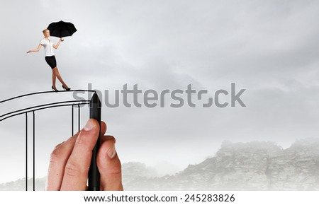 Young businesswoman walking on hand drawn bridge