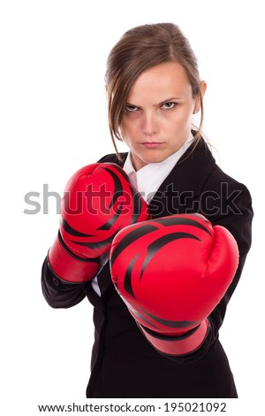 Young businesswoman wearing boxing gloves ready for the competition isolated over white background - stock photo