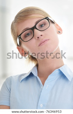 Young businesswoman wearing glasses in office