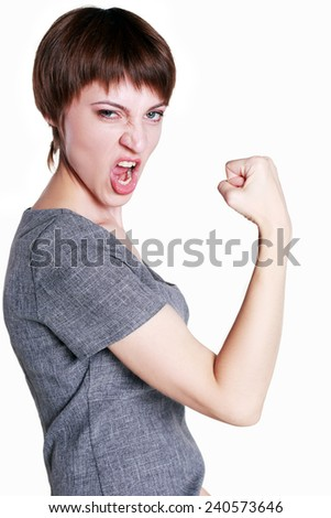 Young businesswoman winning yes and making face on white background  - stock photo