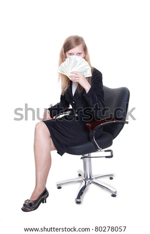 Young businesswoman with a bunch of dollars. Isolated on white. - stock photo