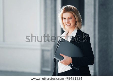 Young businesswoman with a folder - stock photo