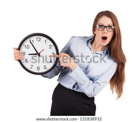 Young businesswoman with a surprised face keeps watch - stock photo