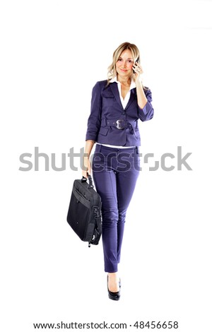 young businesswoman with briefcase talk on the phone - stock photo