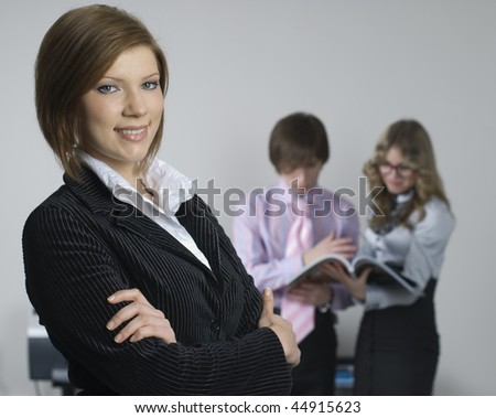 Young businesswoman with business team on background