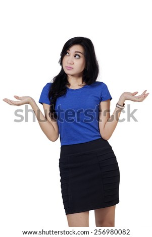 Young businesswoman with confused expression in the studio, isolated over white background - stock photo