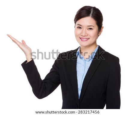 Young businesswoman with hand presentation