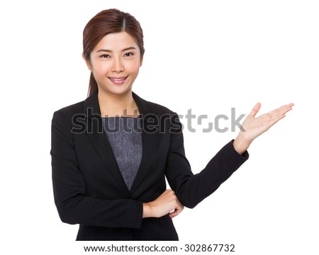 Young businesswoman with hand showing blank sign - stock photo