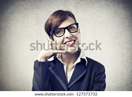 young businesswoman with her hand pretending to be on the phone - stock photo