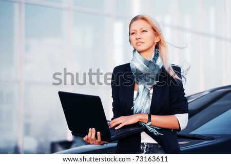 Young businesswoman with laptop - stock photo