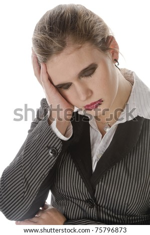 Young businesswoman with lip piercing in a gray business suit and high heels young woman touches his head and has a headache, isolated on a white background - stock photo