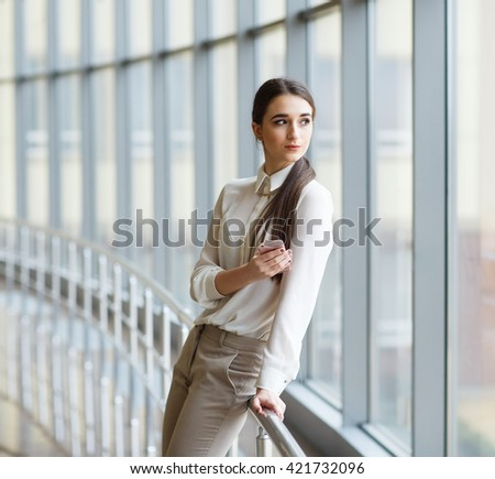 Young businesswoman with mobilephone.
