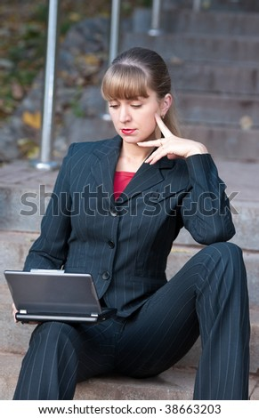 Young businesswoman with notebook outdoors
