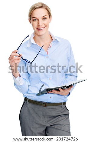 Young businesswoman with notebook writing isolated on white background - stock photo
