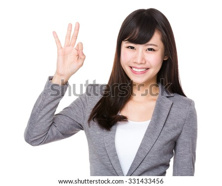 Young Businesswoman with ok sign gesture - stock photo