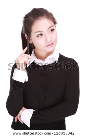 young businesswoman with pen - stock photo