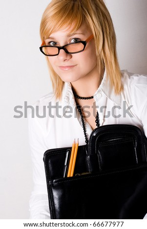 young businesswoman with portfolio on white background - stock photo