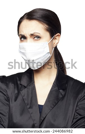 Young businesswoman with protect mask on her face - stock photo