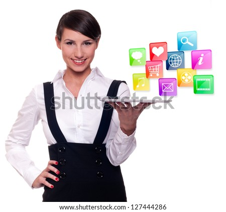 Young businesswoman with tablet computer and mobile and internet technology icons