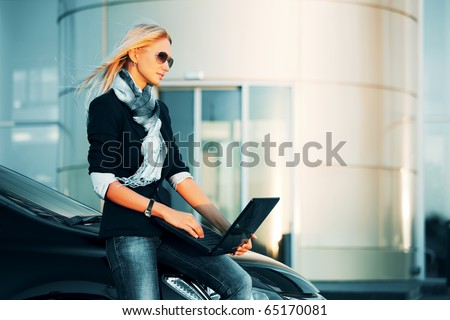 Young businesswoman with the laptop. - stock photo