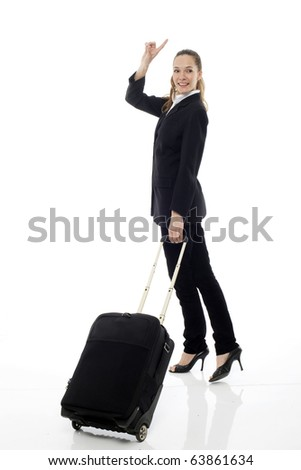 Young businesswoman with trolley on white background studio