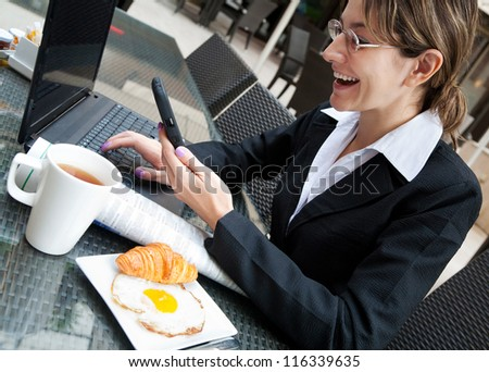 Young businesswoman working in the cafe