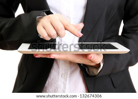 Young businesswoman working on digital tablet,close up, isolated on white - stock photo