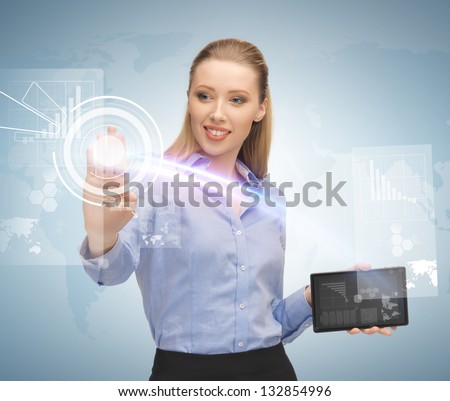 young businesswoman working with tablet pc and virtual screen - stock photo