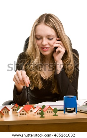 Young businesswoman writing in notebook and calling to phone